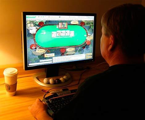 Правительство РФ может легализовать онлайн-покер, фото KAREN BLEIER / AFP