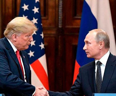 Путин и Трамп впервые за год побеседовали с глазу на глаз
