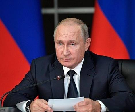 Путин призвал мир реагировать на односторонние санкции