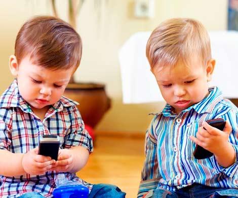 Мобильные телефоны могут вызывать аллергию у детей, фото depositphotos
